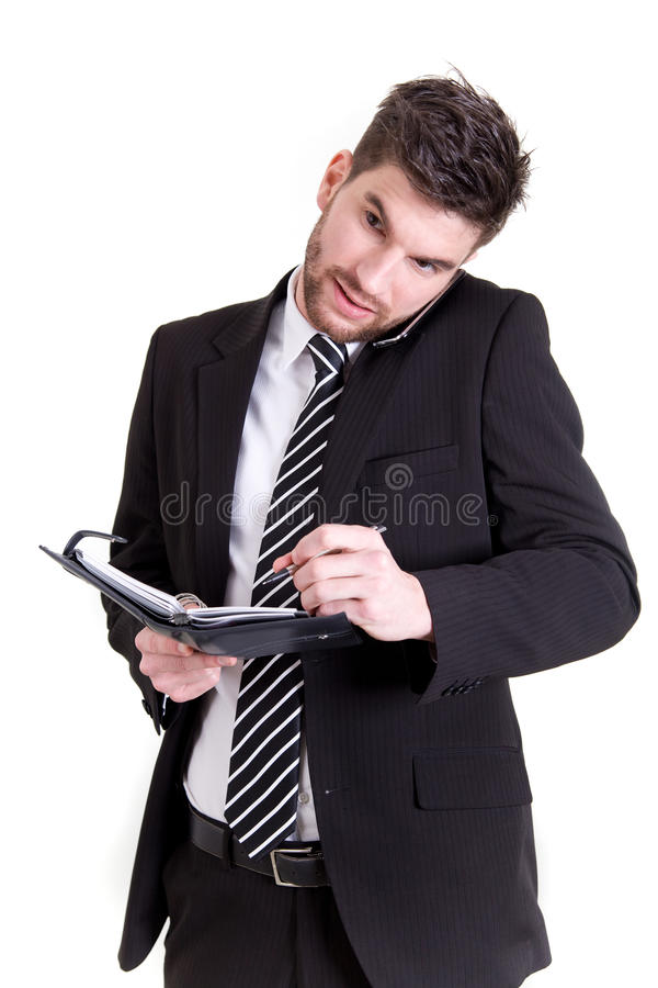 Business man with mobile phone and calendar stock photography
