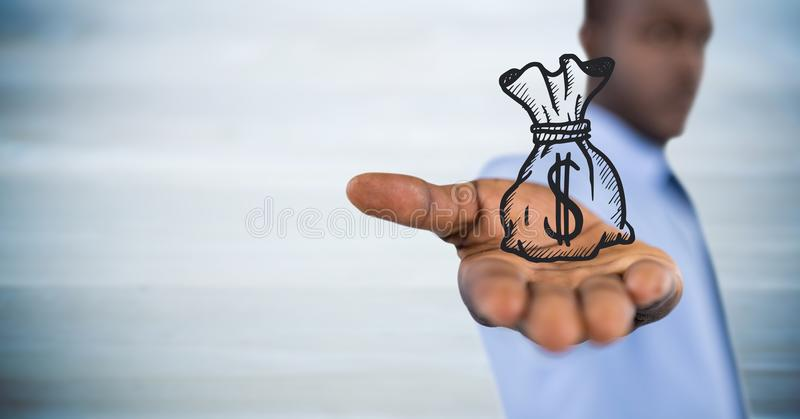 Business man with money bag graphic in outstretched hand against blurry blue wood panel stock images