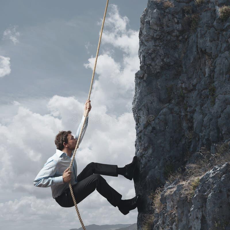 Business man and mountain. Business man climbs a mountain stock photography