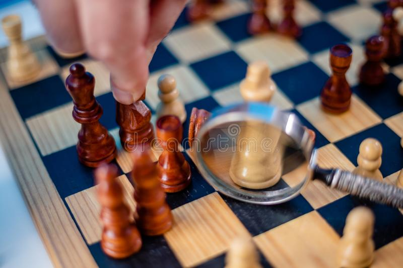 Business man moving chess figure with team behind. strategy or leadership concept royalty free stock photo