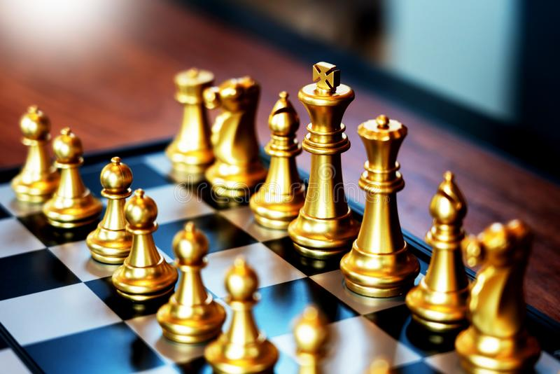 Business man moving chess game for business competition and team work concept stock photography