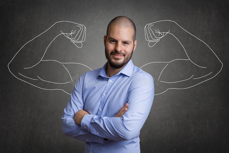 Business man with muscular arms stock photo