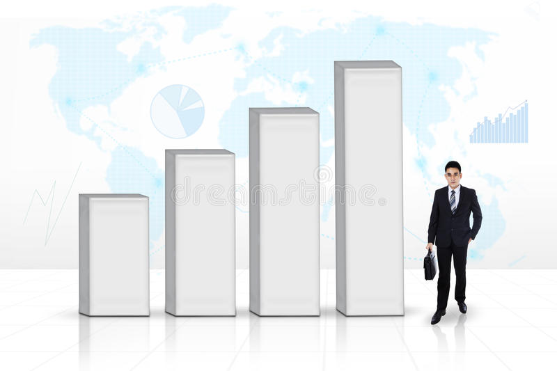 Business man next to a graph. Showing his growth and success royalty free stock image