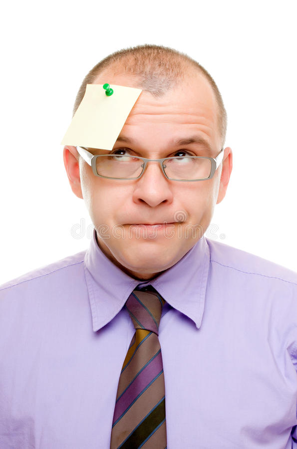 Business man with note pinned on his head stock photography