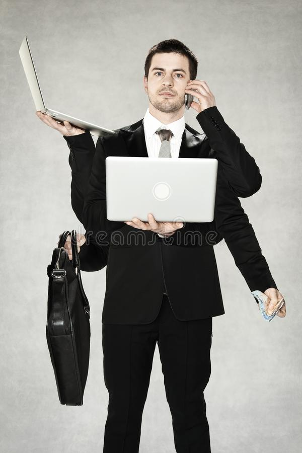 Businessman is a octopus, many hands to do all important things by himself. Business man is a octopus, many hands to do all important things by himself royalty free stock image