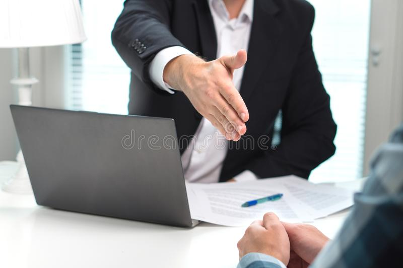 Business man offer and give hand for handshake in office. Successful job interview. Apply for loan in bank. Salesman, bank worker or lawyer shake for deal royalty free stock photography