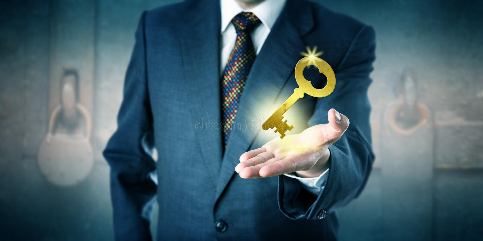 Business Man Offering A Golden Key In Open Palm. Business man is offering a golden key in his open palm. Business concept for key to success, access to knowledge stock photos