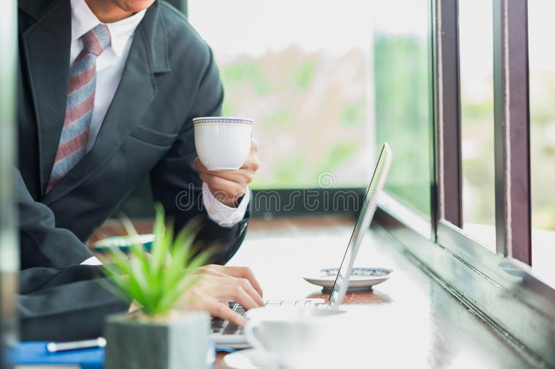 Business man at office desk working together on a laptop, teamwork concept royalty free stock photo