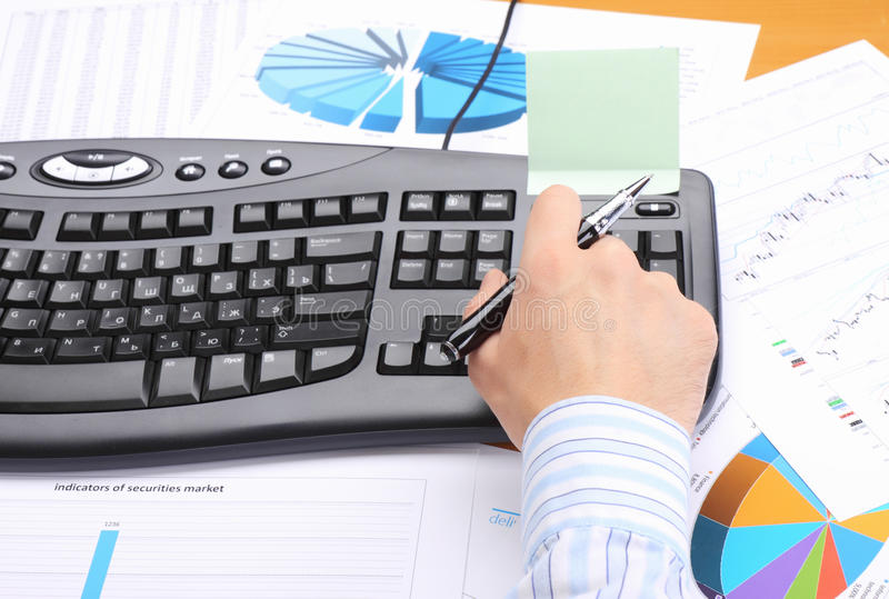 Business man at office working at his workplace. royalty free stock photos