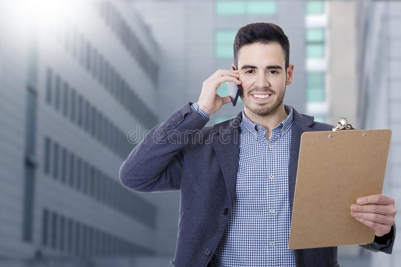 Business man and offices. With mobile phone stock images