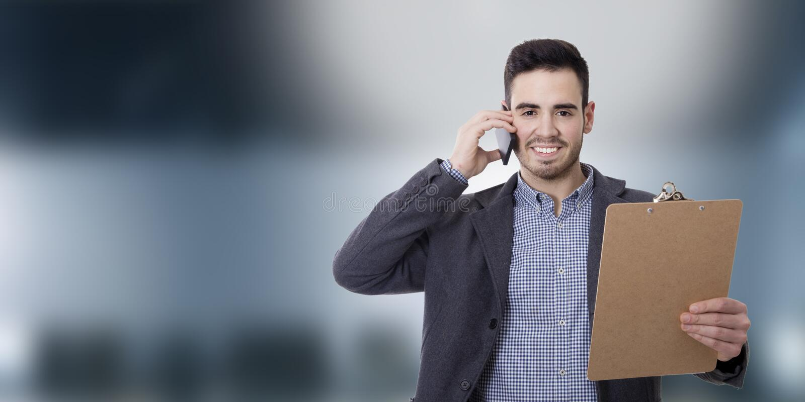 Business man and offices. With mobile phone stock photography