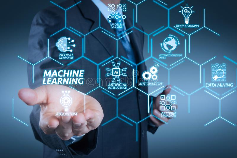Business man with an open hand as showing something. Machine learning technology diagram with artificial intelligence (AI),neural network,automation,data mining stock photography