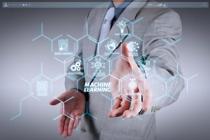 Business man with an open hand as showing something. Machine learning technology diagram with artificial intelligence (AI),neural network,automation,data mining royalty free stock photos