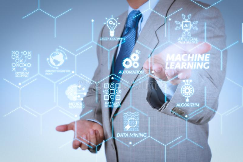 Business man with an open hand as showing something. Machine learning technology diagram with artificial intelligence (AI),neural network,automation,data mining royalty free stock photo