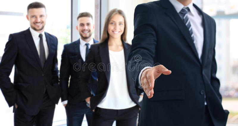 Business man with an open hand. Business men with an open hand ready to seal a deal stock images