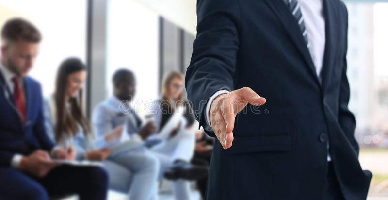 Business man with an open hand. Business men with an open hand ready to seal a deal royalty free stock photography