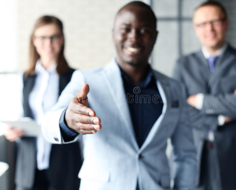 Business man with an open hand. Portrait of an African American business men with an open hand ready to seal a deal royalty free stock photos