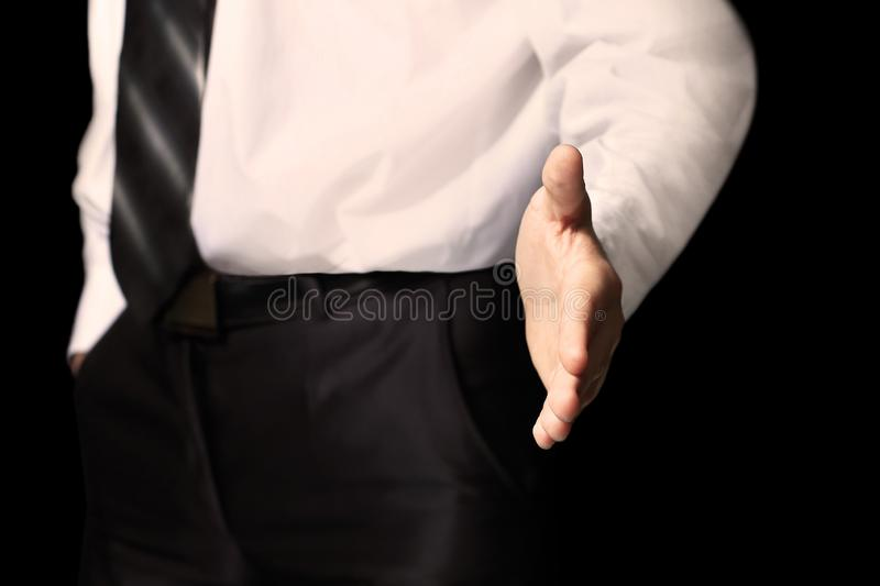 Business man with an open hand ready to seal a deal. Business man with an open hand ready seal a deal royalty free stock images
