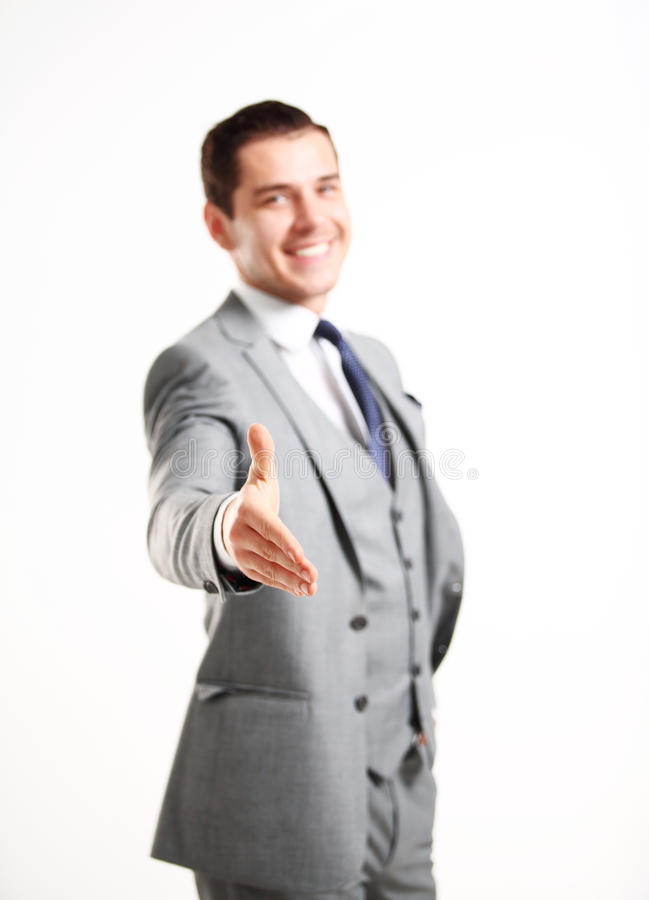 Business man with an open hand ready to seal a deal. A business man with an open hand ready to seal a deal royalty free stock image