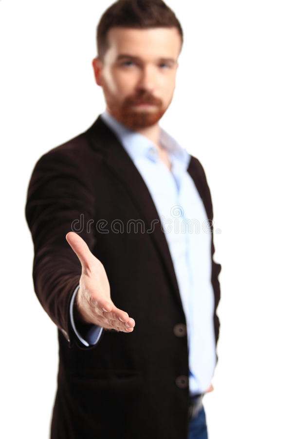 Business man with an open hand ready to seal a deal royalty free stock image