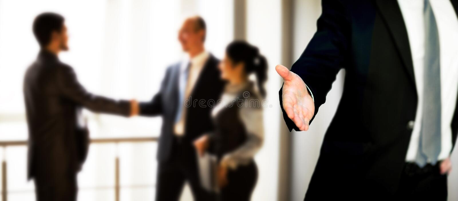 A business man with an open hand. Ready to seal a deal royalty free stock photo