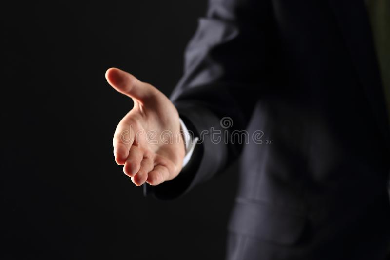 Business man with an open hand. Ready to seal a deal royalty free stock photos
