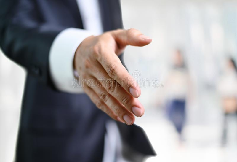 Business man open hand ready to seal a deal, partner shaking hands.  stock photos