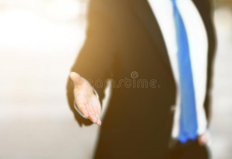 Business man with an open hand ready to seal a deal stock photography
