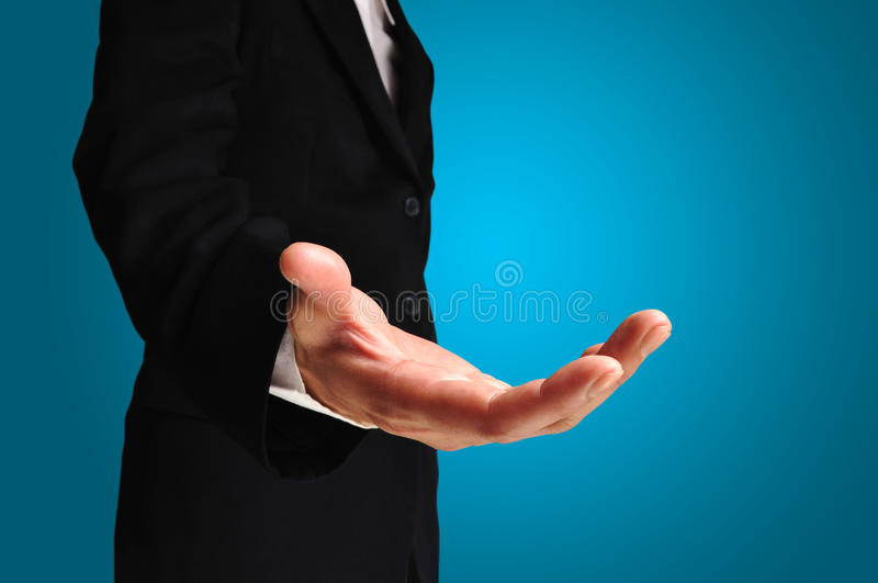 A business man with an open hand royalty free stock photo
