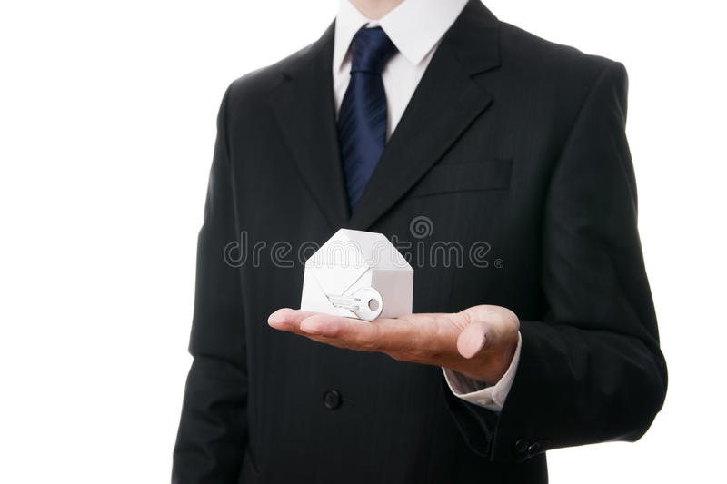 Business man with a paper house in the hand royalty free stock images