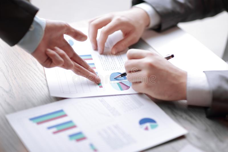Business man and Partner are proposing business plans to young entrepreneurs to enhance. Long-term trading performance royalty free stock photography