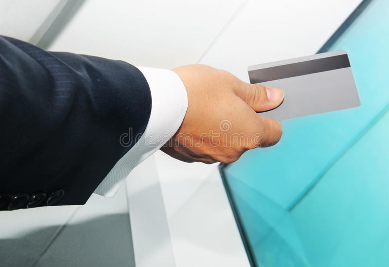 Business man paying with a credit or debit card. e royalty free stock photos
