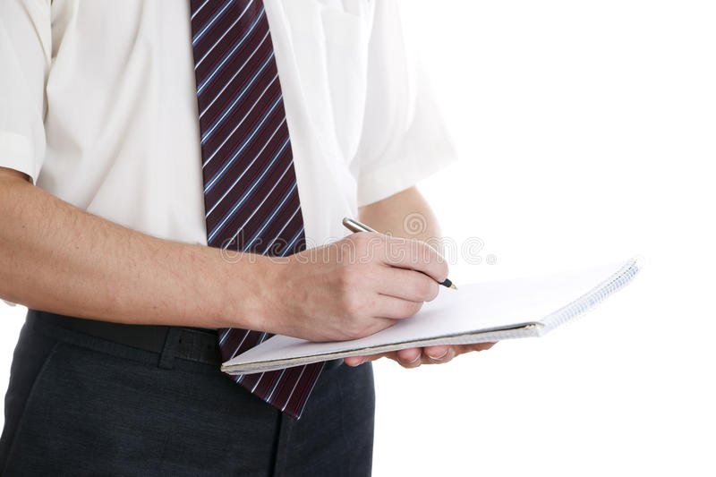 Business man with pen and notepad stock photos