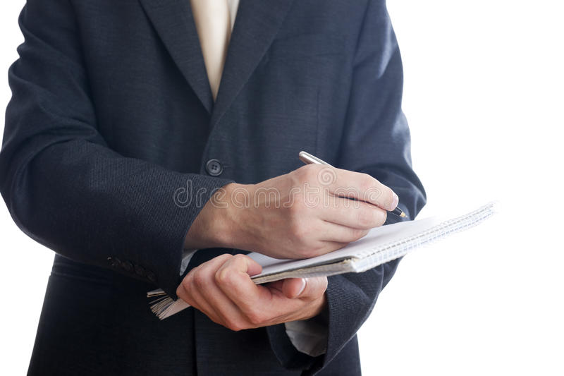 Business man with pen and notepad stock photo