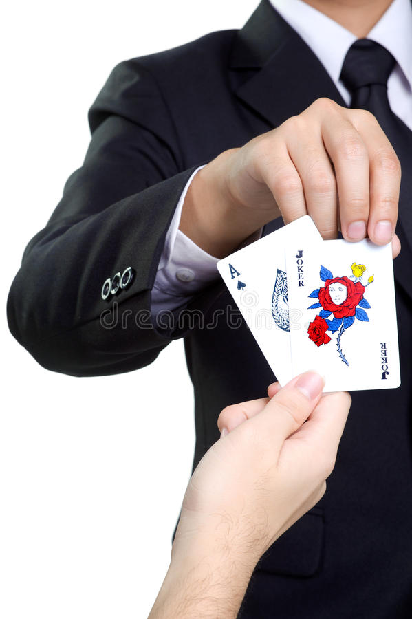 Business man picks card joker in isolated royalty free stock image