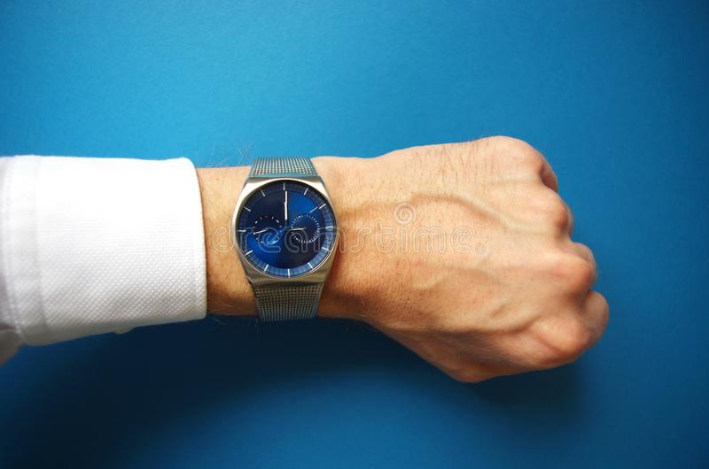 Business man pointing at hand watch, success and business concept, time management royalty free stock photos