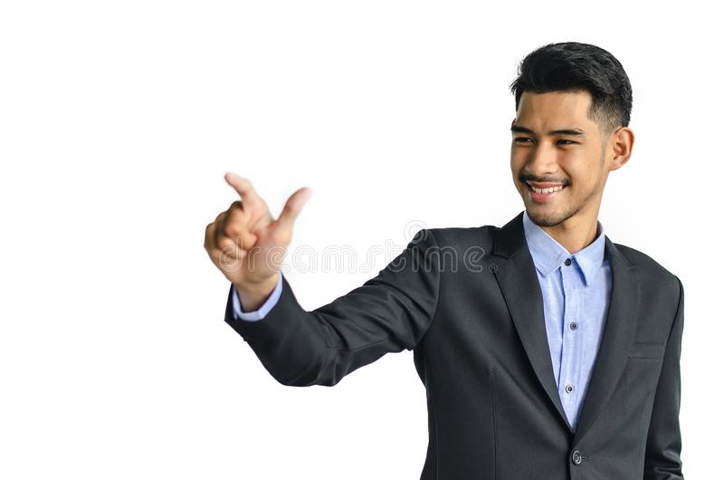 Business man pointing at something interesting on a white background royalty free stock photos