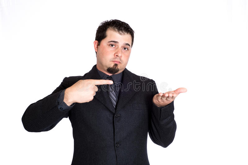 Business man pointing to product. A businessman pointing at empty hand for product placement. White background stock photo