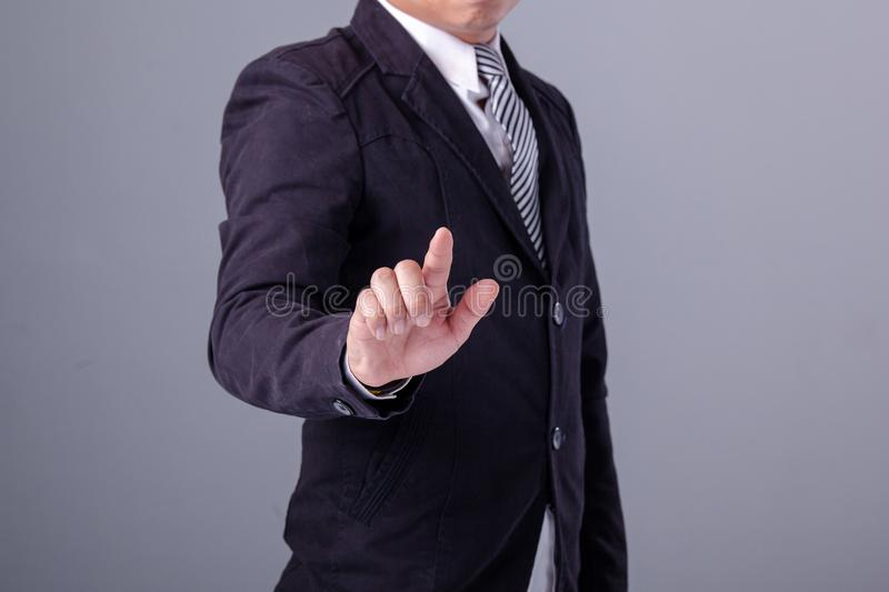 Business man with pointing to something or touching stock photo
