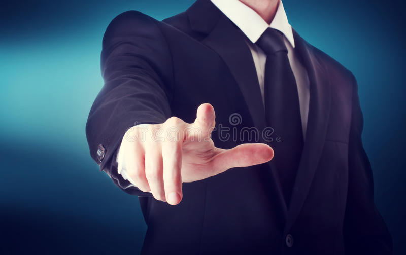 Business man with pointing to something or touching a touch screen stock photo