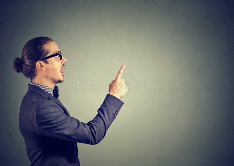 Business man pointing up has an idea stock photos