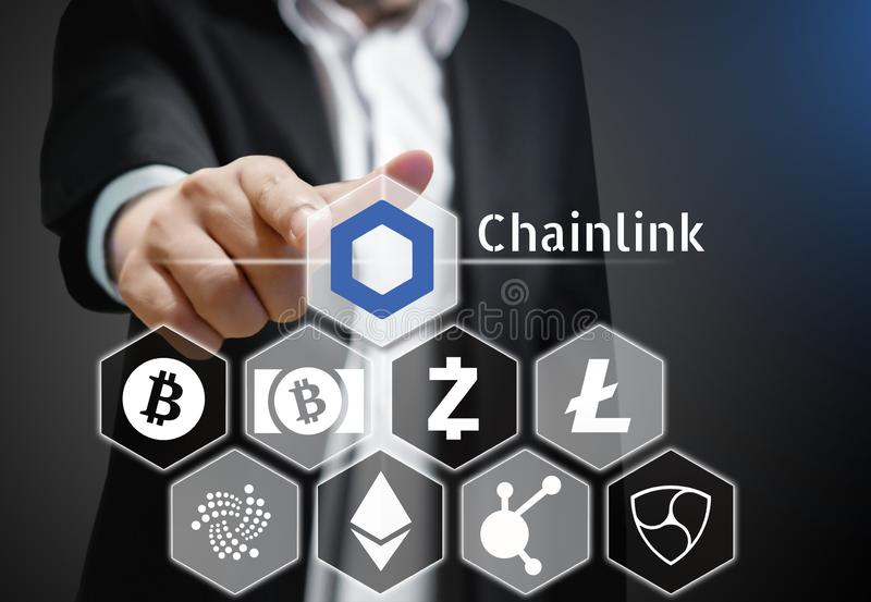 Business man points his finger at Chainlink coin icon among others Cryptocurrency on Virtual Touch Screen. Conceptual stock illustration