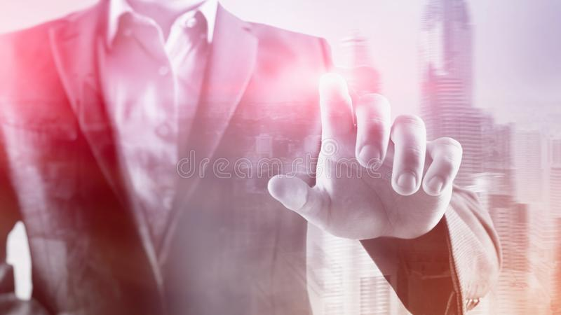 Business man points his finger at you in the office. City background stock photos