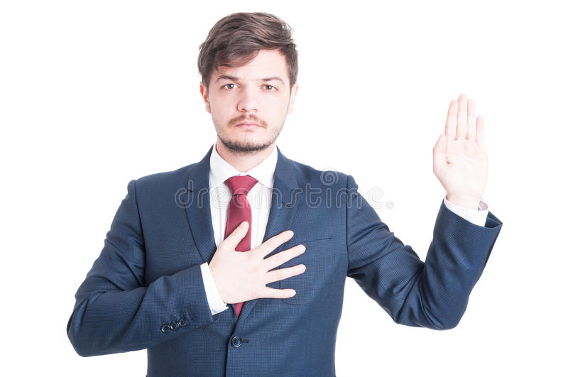 Business man or politician standing raising hand taking oath. Isolated on white background stock image