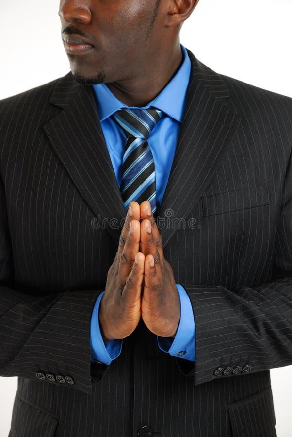 Business man praying royalty free stock photos