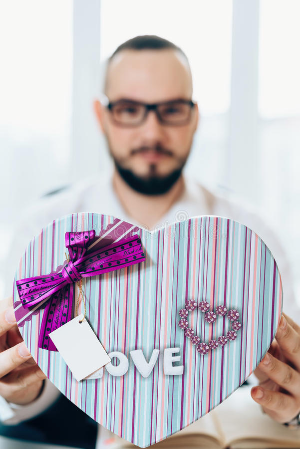Business man prepared a gift in the form of heart royalty free stock image