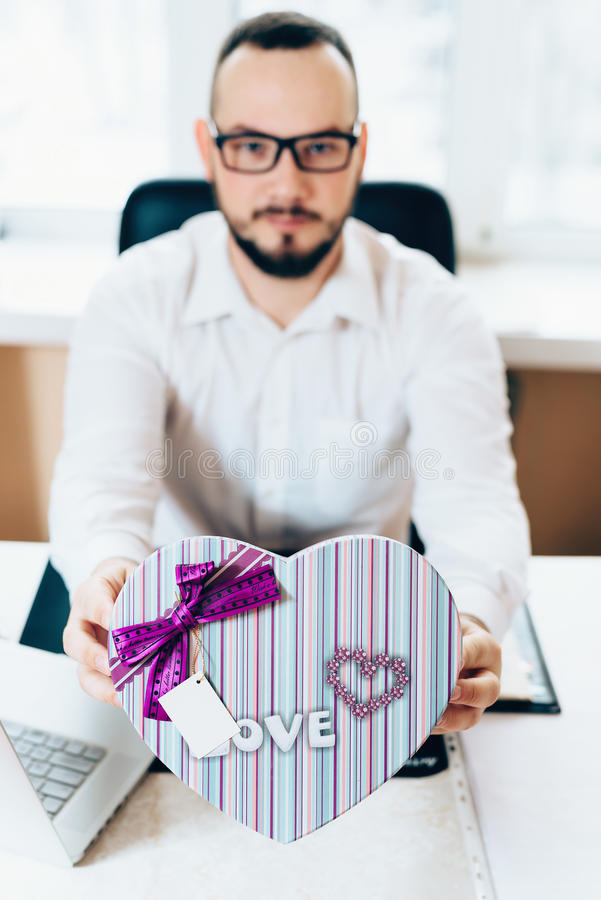Business man prepared a gift in the form of heart stock photos