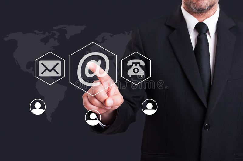 Business man pressing contact us using email digital button royalty free stock image