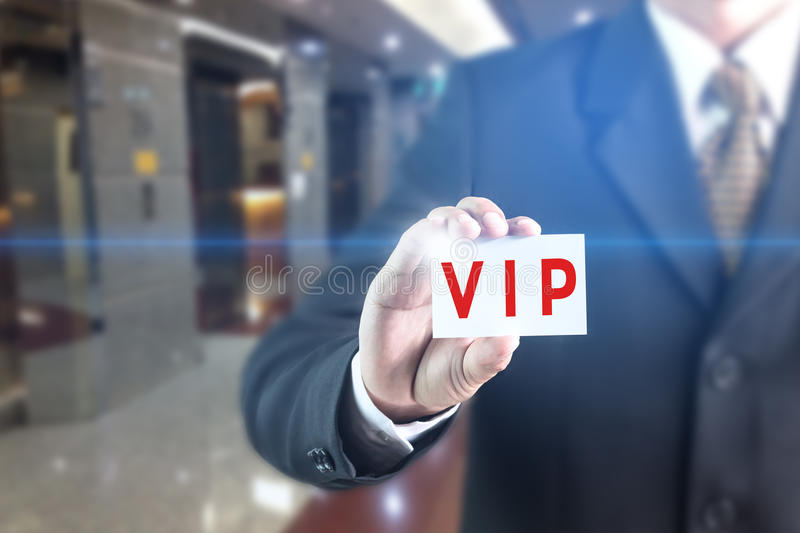 Business man pressing hand VIP button word on virtual screen stock photo