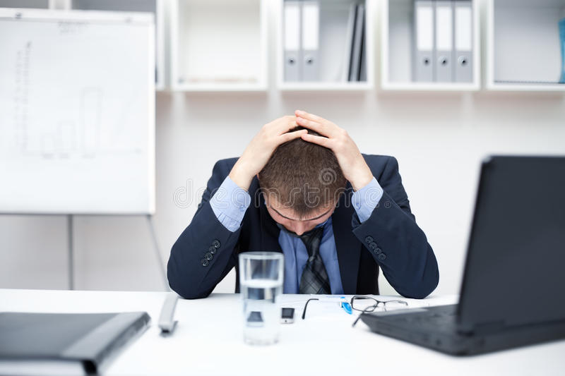 Business man with problems and stress royalty free stock photo